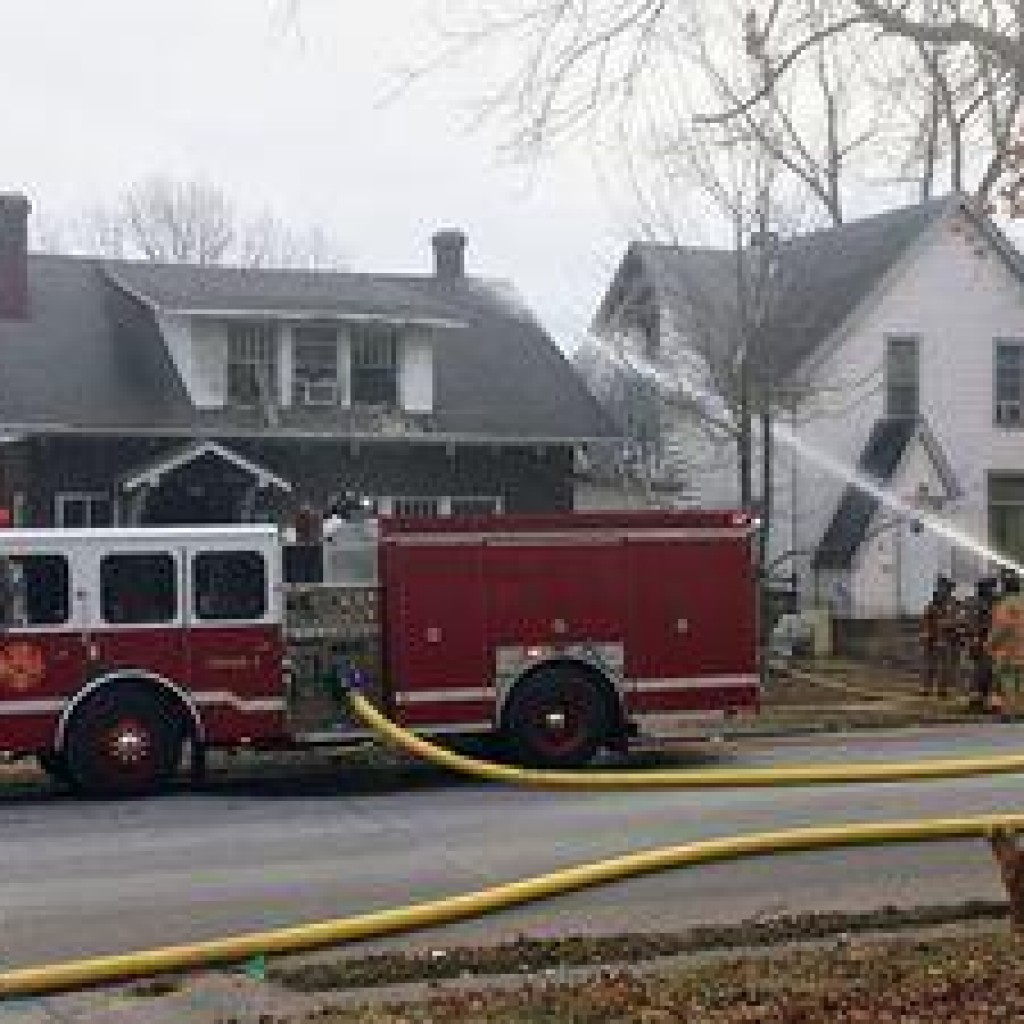 Firefighters working the scene of a house fire that extended to the neighboring residence January 14th, 2017