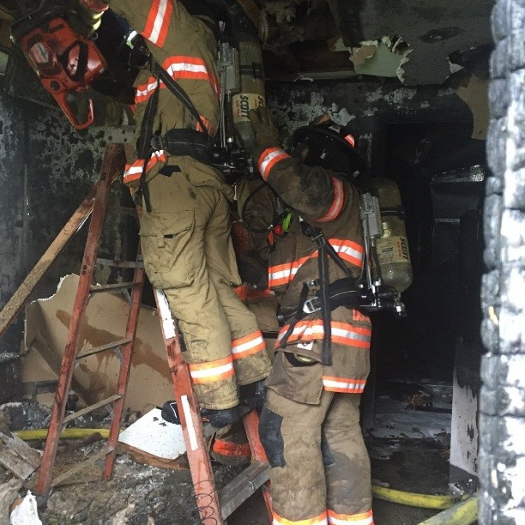 Firefighters checking for fire extension inside the residence at 907 N 10th St May 3, 2017