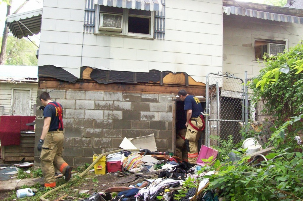 Crews inspect the damage after a basement fire 719 Washington June 20th 2017
